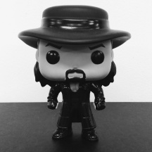 The Undertaker (WWE). Of course I can't miss out on a miniature version of my childhood hero.