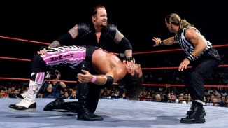 The Undertaker vs. Bret Hart and Shawn Michaels as the special guest referee. WWE SummerSlam. 1997