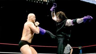 The Undertaker vs. Stone Cold Steve Austin. Sometimes in 1994-1996.