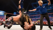 The Undertaker applying the Hell's Gate submission move on Edge. WWE WrestleMania XXIV. 2008.